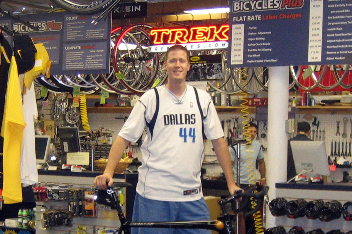 Shawn Bradley, shown here, riding his $10,000 custom made bicycle which was stolen in a recent burglary.