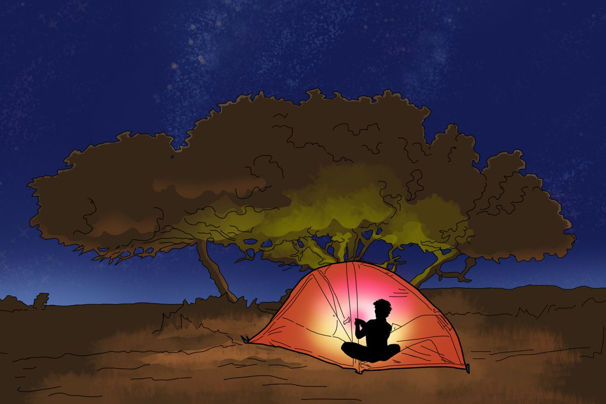In a camping tent out in the wilderness at night, a gamer uses their phone to stream a game, illuminating the darkness with pink light.