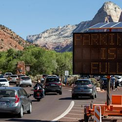 An electronic sign indicates that the parking lot at the Zion National Park Visitor Center is full on Thursday, Sept. 15, 2016. In Springdale, the 3.5-mile Main Street is crammed with cars that often overflow into residents' driveways and impede everyday business.