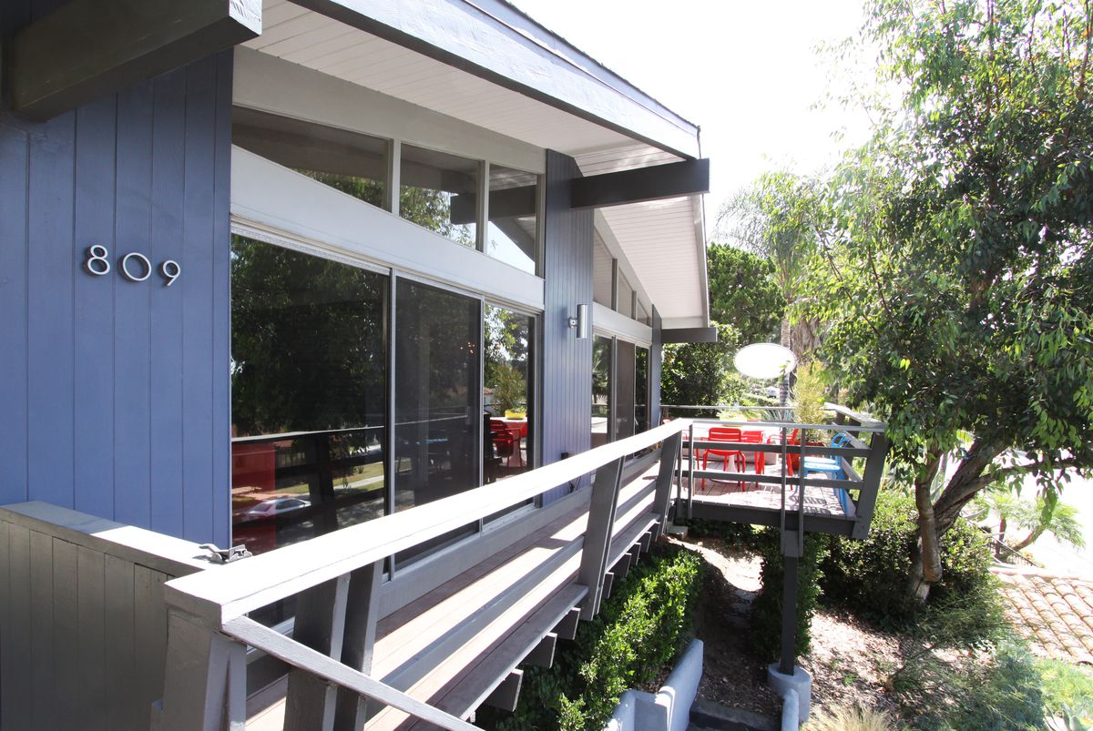 Exterior of house with deck