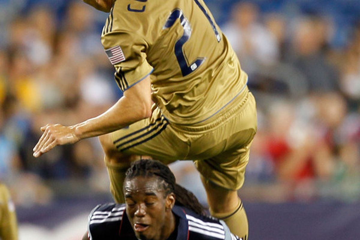 FOXBORO MA - AUGUST 28:  Shalrie Joseph #21 of the New England Revolution battles Eduardo Coudet #21 of the Philadelphia Union at Gillette Stadium on August 28 2010 in Foxboro Massachusetts. (Photo by Jim Rogash/Getty Images)
