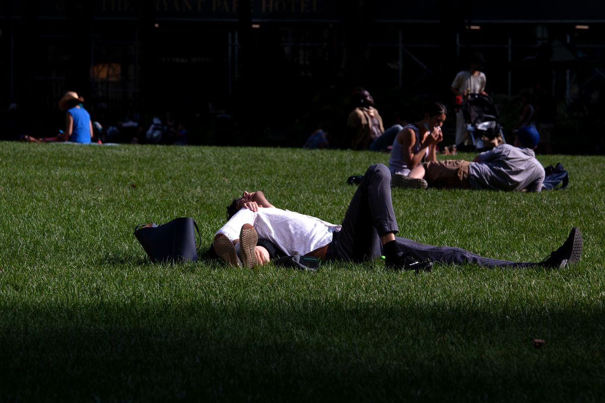 A couple enjoys socially distanced lounging in Bryant Park, July 15, 2020.