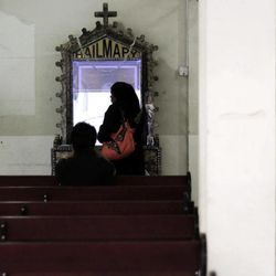 In this Thursday, Aug. 30, 2012 photo, worshipers pray at Sacred Heart Church in Manama, Bahrain. When Bahrain announced plans to build the largest Roman Catholic Church in the Gulf, it was accompanied by a noticeable dose of pride to showcase its traditions of religious tolerance. Instead, the planned church has turned into another point of tension in a country already being pulled apart by internal sectarian battles.
