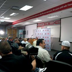 The media gather in Ohio State's meeting room to speak to Urban Meyer.