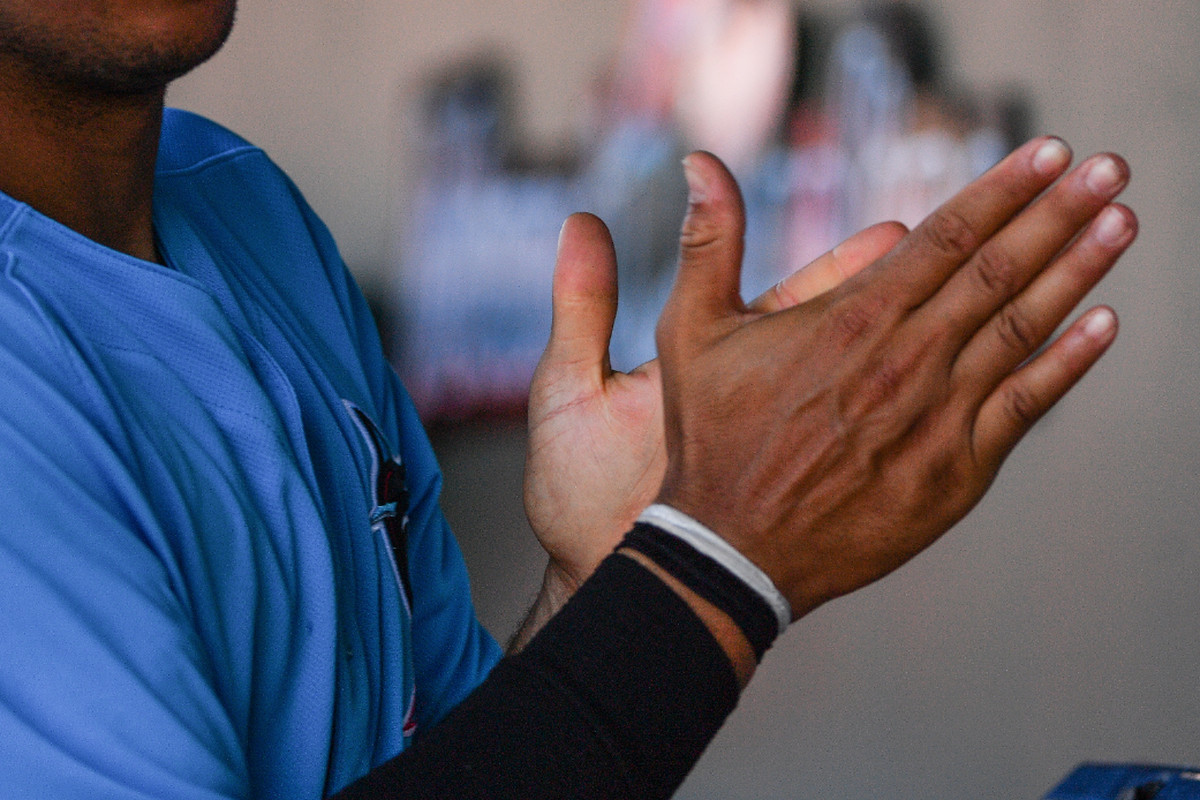 Joe Dunand #35 of the Miami Marlins uses hand sanitizer after the spring training game against the St. Louis Cardinals at Roger Dean Chevrolet Stadium