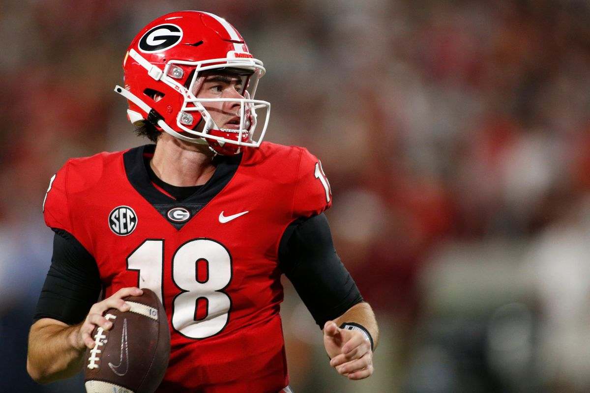 Georgia quarterback JT Daniels looks to throw a pass during the second half of an NCAA college football game between South Carolina and Georgia in Athens, Ga., on Sept. 18, 2021.