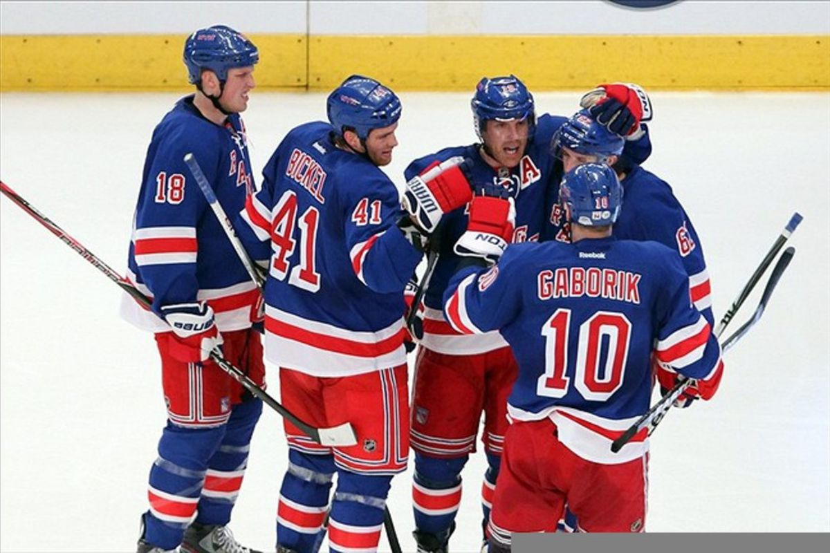 Mar 13 2012; New York, NY, USA;  New York Rangers center Brad Richards (19) and teammates celebrate scoring during the second period against the Carolina Hurricanes at Madison Square Garden.  Mandatory Credit: Anthony Gruppuso-US PRESSWIRE