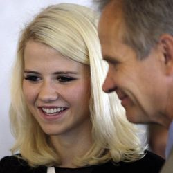 Elizabeth Smart, along with her father Ed Smart, talks with attendees after speaking during The Family Support Center Blue Ribbon Breakfast in Salt Lake City  Wednesday, Sept. 14, 2011. The center assists child abuse prevention and treatment programs and homeless assistance.