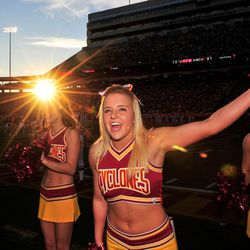 An Iowa State Cyclones cheerleader cheers on her team as the sun sets behind Sun Devil Stadium during the 2nd quarter of a game against the Minnesota Golden Gophers in the 2009 Insight Bowl.