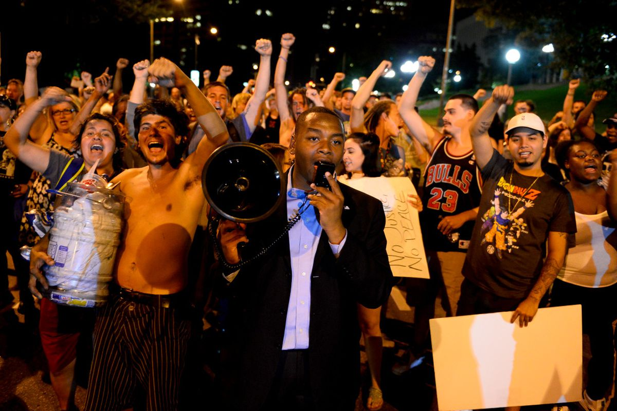 """Tay Anderson leads a chant of """"Black lives matter!"""" with a crowd of protestors in July 2016."""