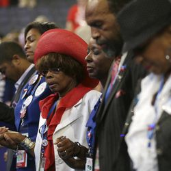 North Carolina delegates pray during the Democratic National Convention in Charlotte, N.C., on Wednesday, Sept. 5, 2012.
