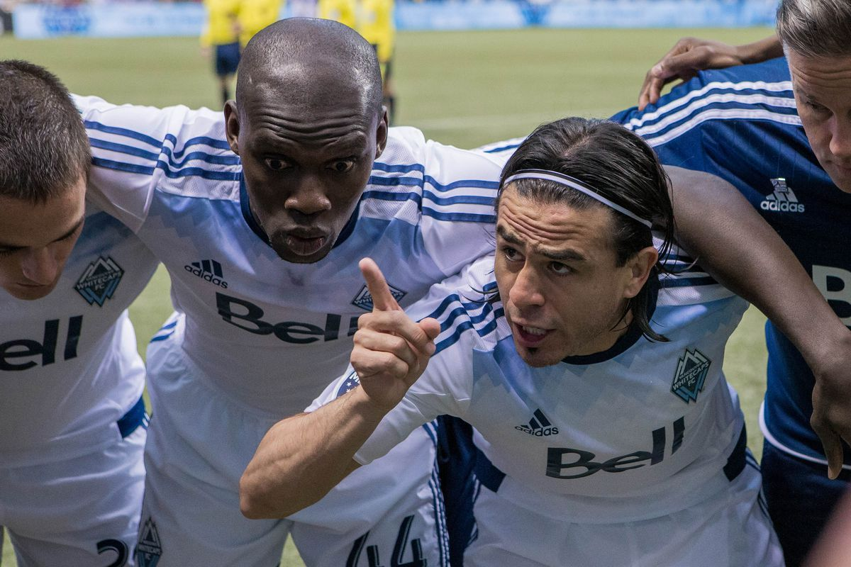 Pa Modou Kah (C) and Mauro Rosales (R) are two of the 30-something Whitecaps.  Would you bring either of them back for 2016?