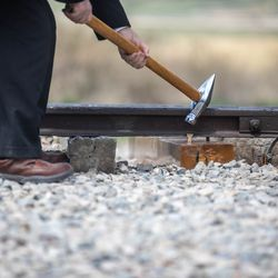 A silver maul is used to tap a replica of the golden spike into a rail at Golden Spike National Historic Park near Corrine, Box Elder County, on Monday, May 10, 2021. Visitors gathered at the park to mark the 152nd anniversary of the completion of the nation's first transcontinental railroad and to watch a reenactment of the 1869 ceremony.