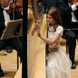 Caroline Richards performs on the harp during the 55th annual Salute to Youth concert in Salt Lake City Tuesday, Sept. 30, 2014.