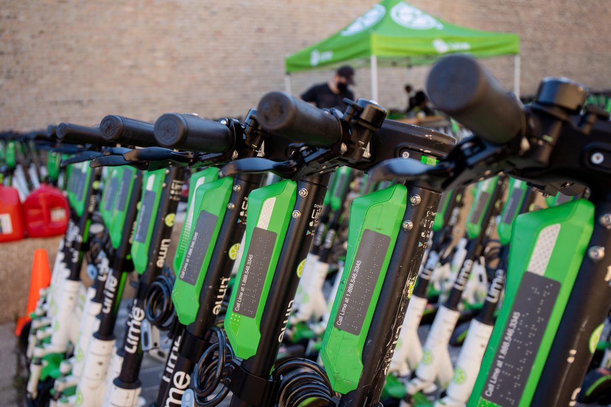 Braille signs are attached to Lime scooters that are parked outside a warehouse in West Town Wednesday morning, Aug. 12, 2020. Lime deployed 1,000 scooters across Chicago Wednesday.