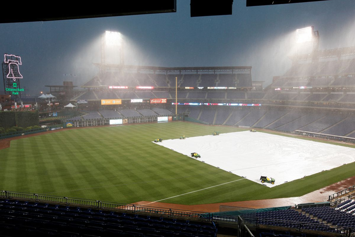 Heavy rains postpone the Phillies' home opener to Tuesday.