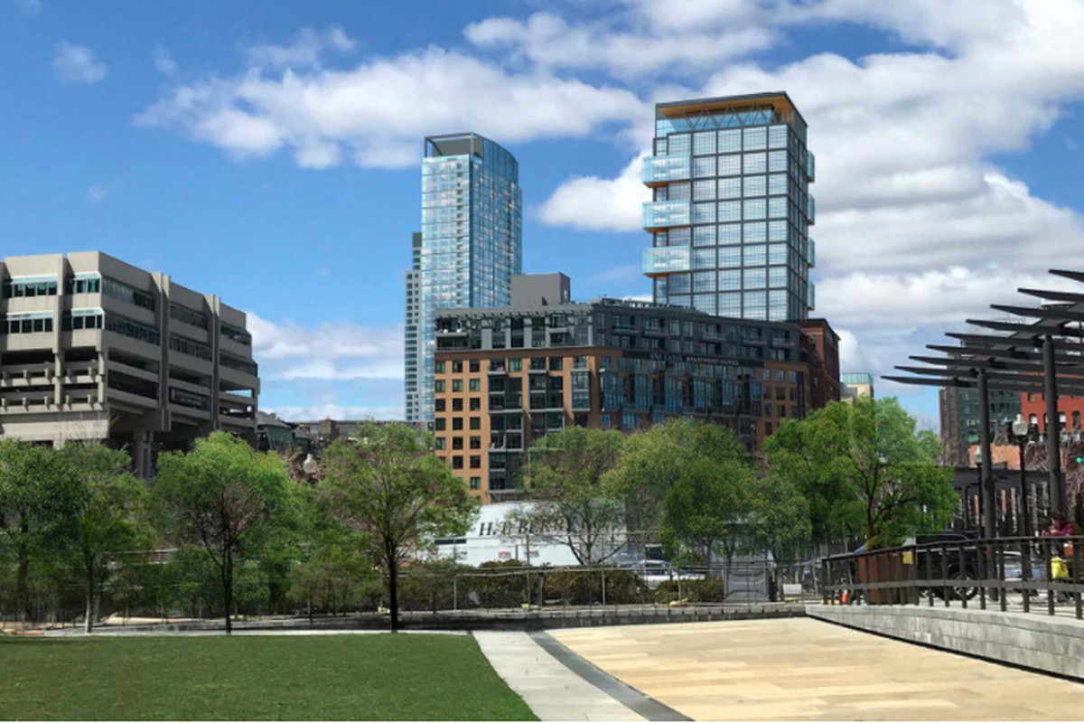 A rendering of two glassy buildings as seen from a distant city park.