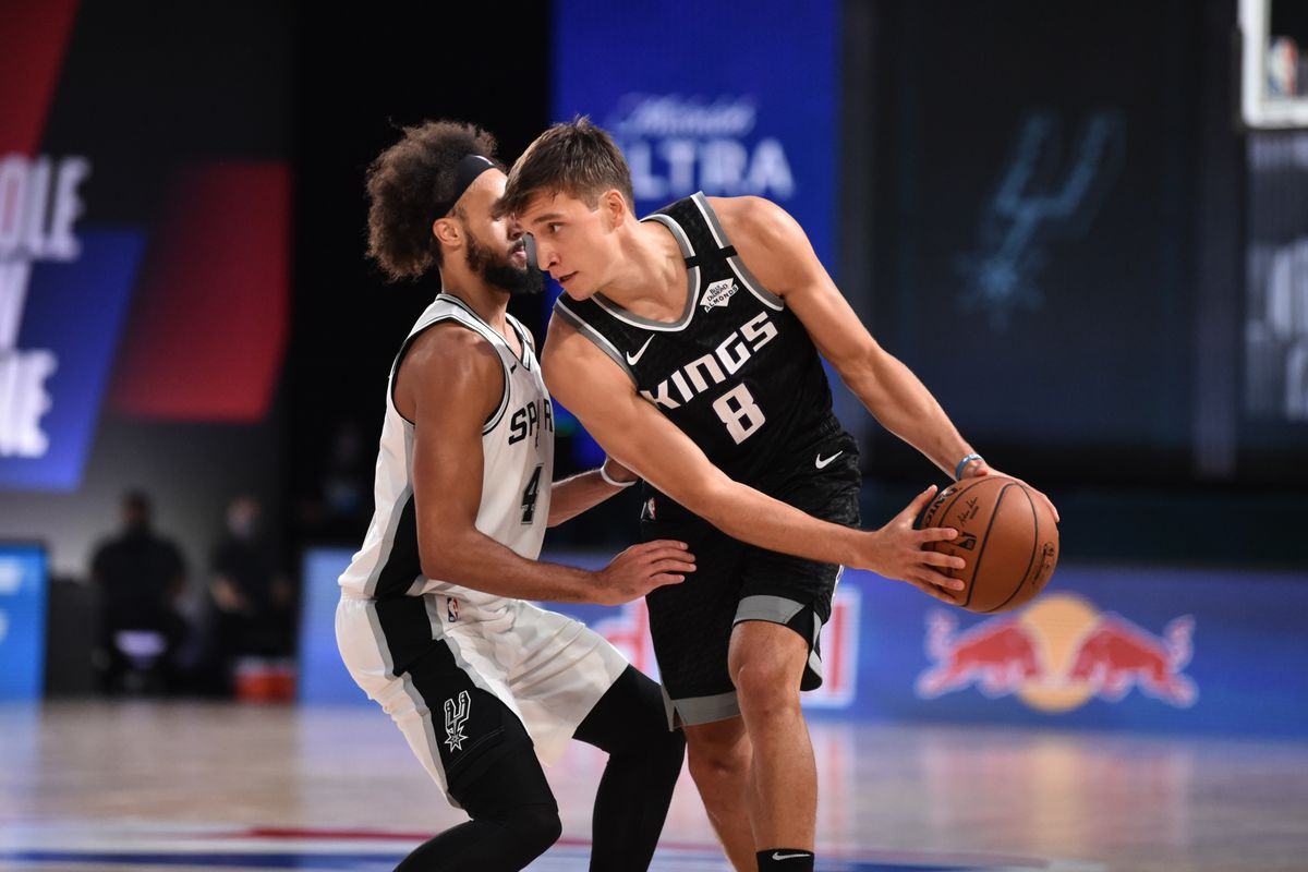 Bogdan Bogdanovic of the Sacramento Kings handles the ball against the San Antonio Spurs during a game on July 31, 2020 at Visa Athletic Center at ESPN Wide World of Sports in Orlando, Florida.