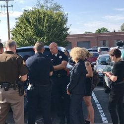 Salt Lake City Police Chief Mike Brown, Mayor Jackie Biskupski, Utah Department of Public Safety Commissioner Keith Squires and others meet as Operation Rio Grande gets underway early Monday, Aug. 14, 2017.
