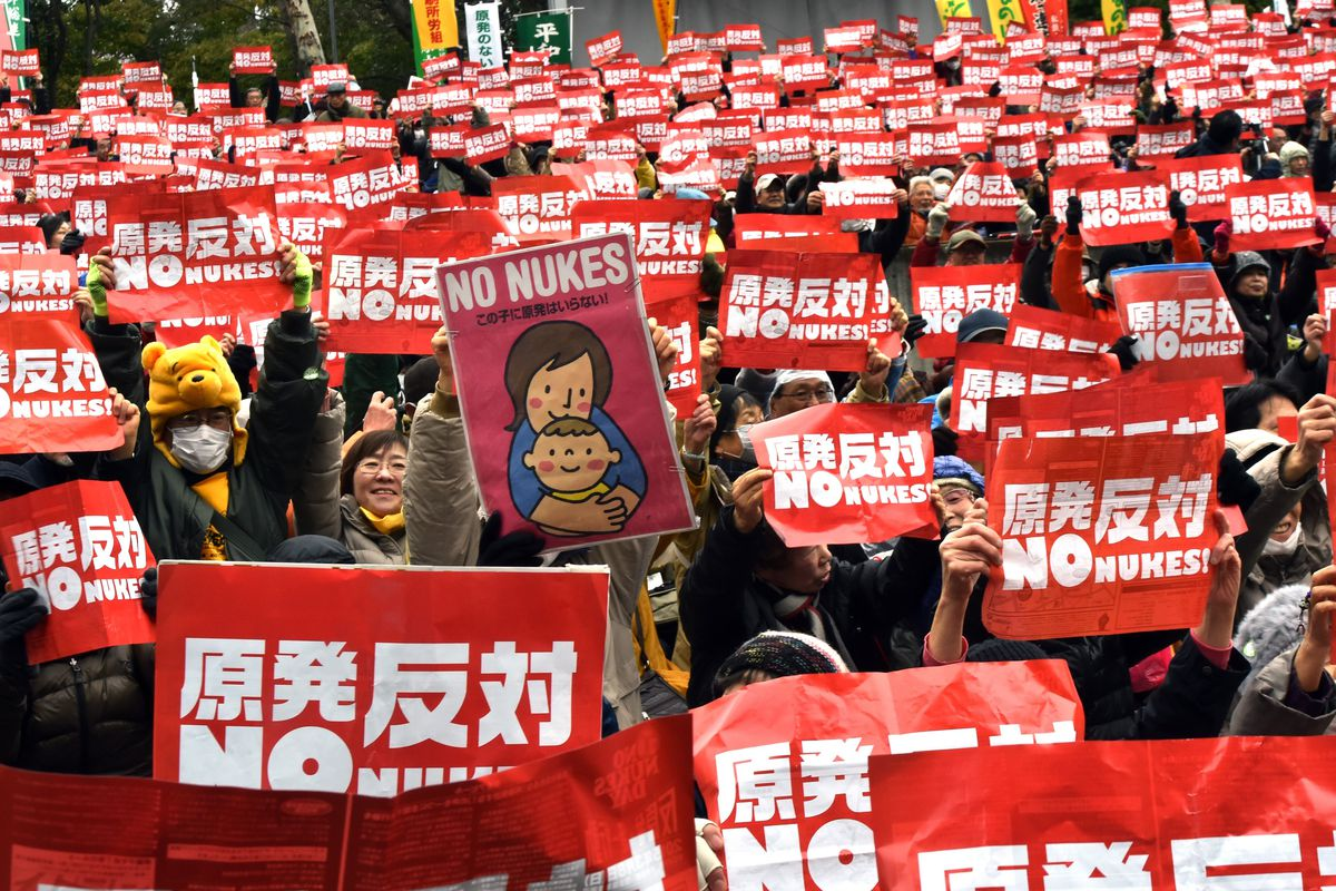 Protestors raise anti nuclear placards at a rally denouncing nuclear power plants in Tokyo on March 8, 2015.