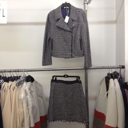 Suddenly, we feel the need to channel Cher from <i>Clueless</i> while wearing this tweed jacket and skirt combo. The jacket goes for $175 and the skirt is $65.