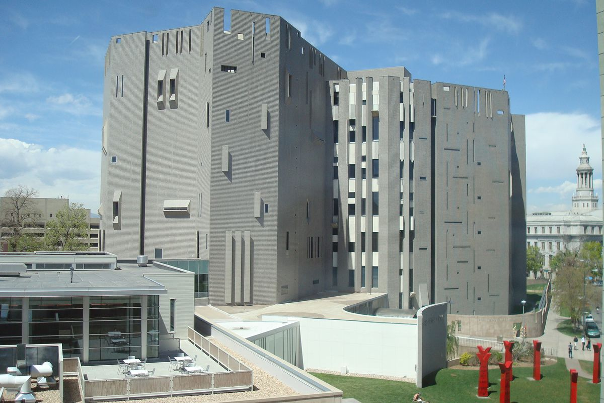 The exterior of the Denver Art Museum. The facade is grey and there are multiple windows.