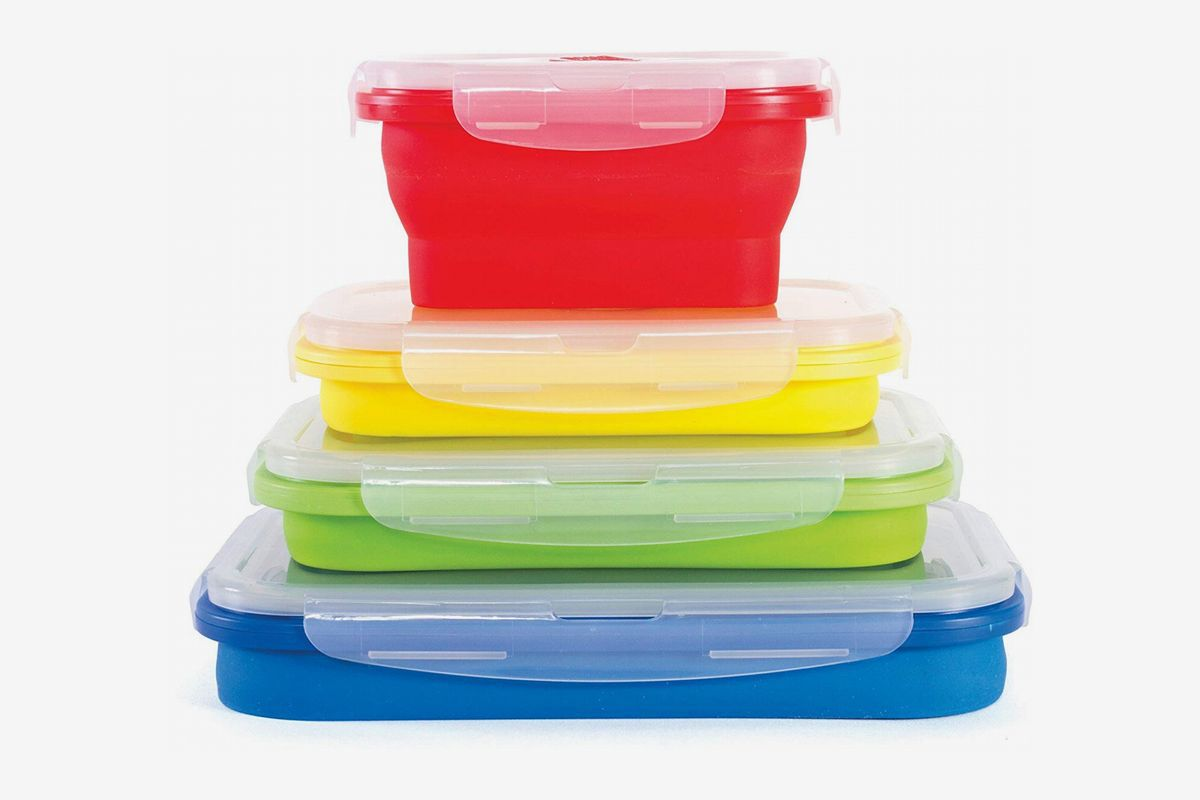 A stack of four assorted collapsible containers in varying sizes and colors
