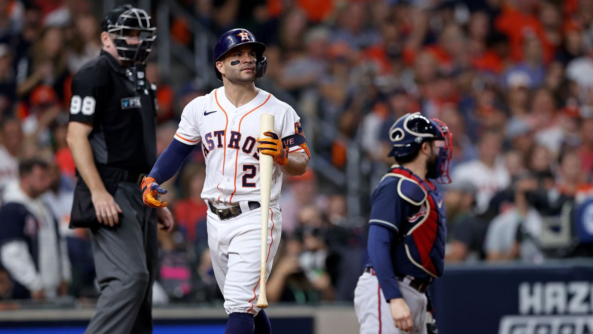 Jose Altuve #27 of the Houston Astros reacts after striking out against the Atlanta Braves during the seventh inning in Game One of the World Series at Minute Maid Park on October 26, 2021 in Houston, Texas.