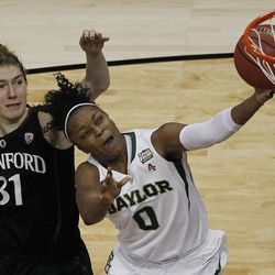 Baylor guard Odyssey Sims (0) shoots under pressure from Stanford guard Toni Kokenis (31) during the second half of an NCAA women's Final Four semifinal college basketball game, in Denver, Sunday, April 1, 2012. Baylor defeated Stanford 59-47.