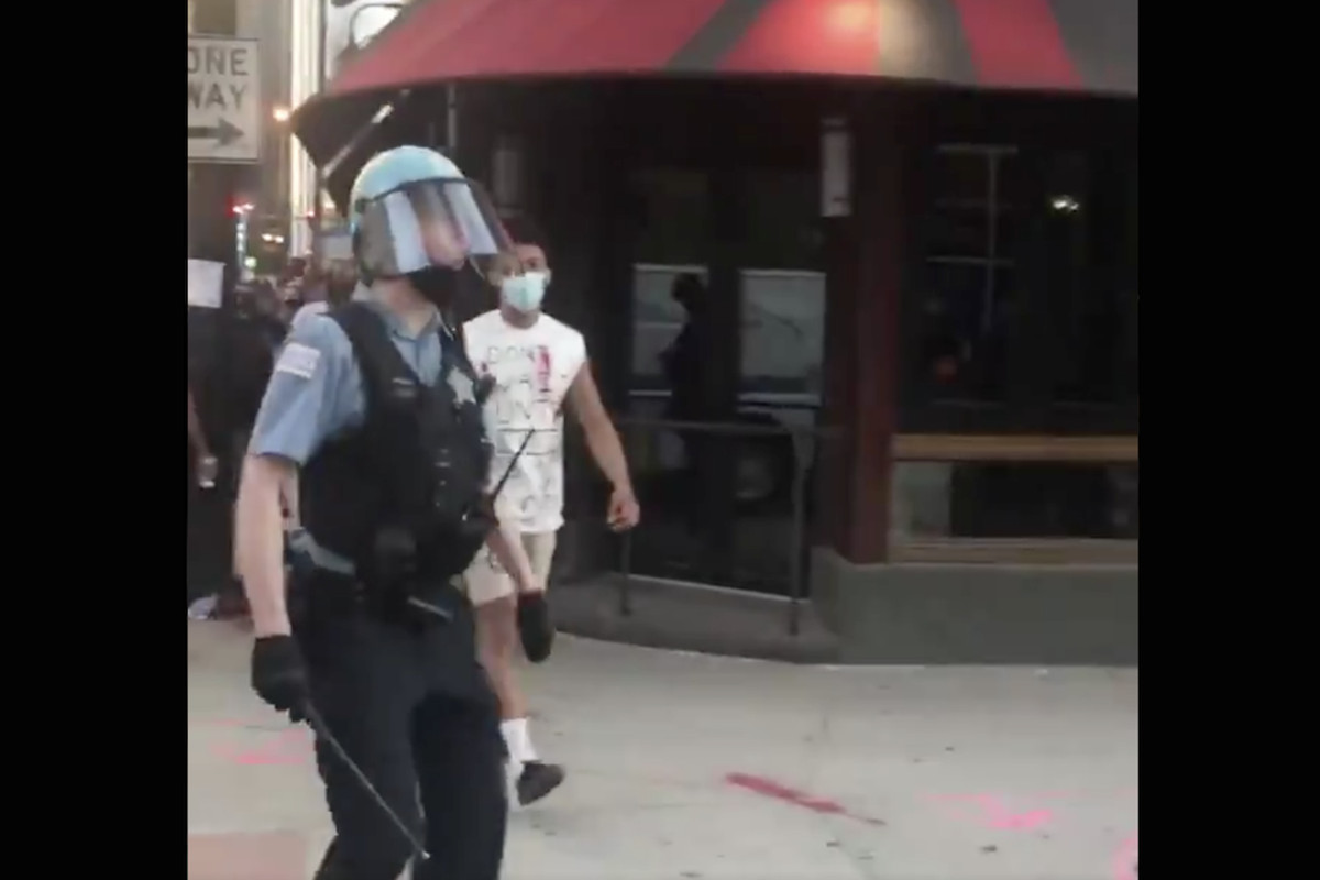 Screenshot from a video posted to social media allegedly showing a Chicago police officer use a homophobic slur at a protest May 30, 2020.