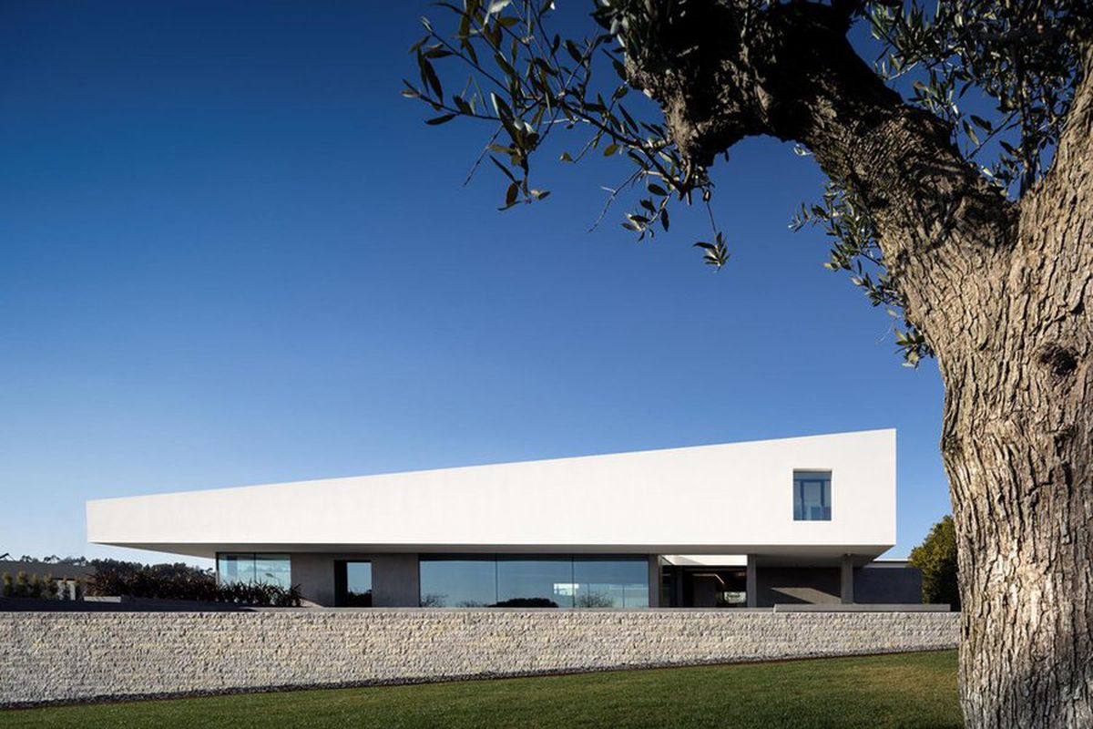 Modern house with angled white volume on top