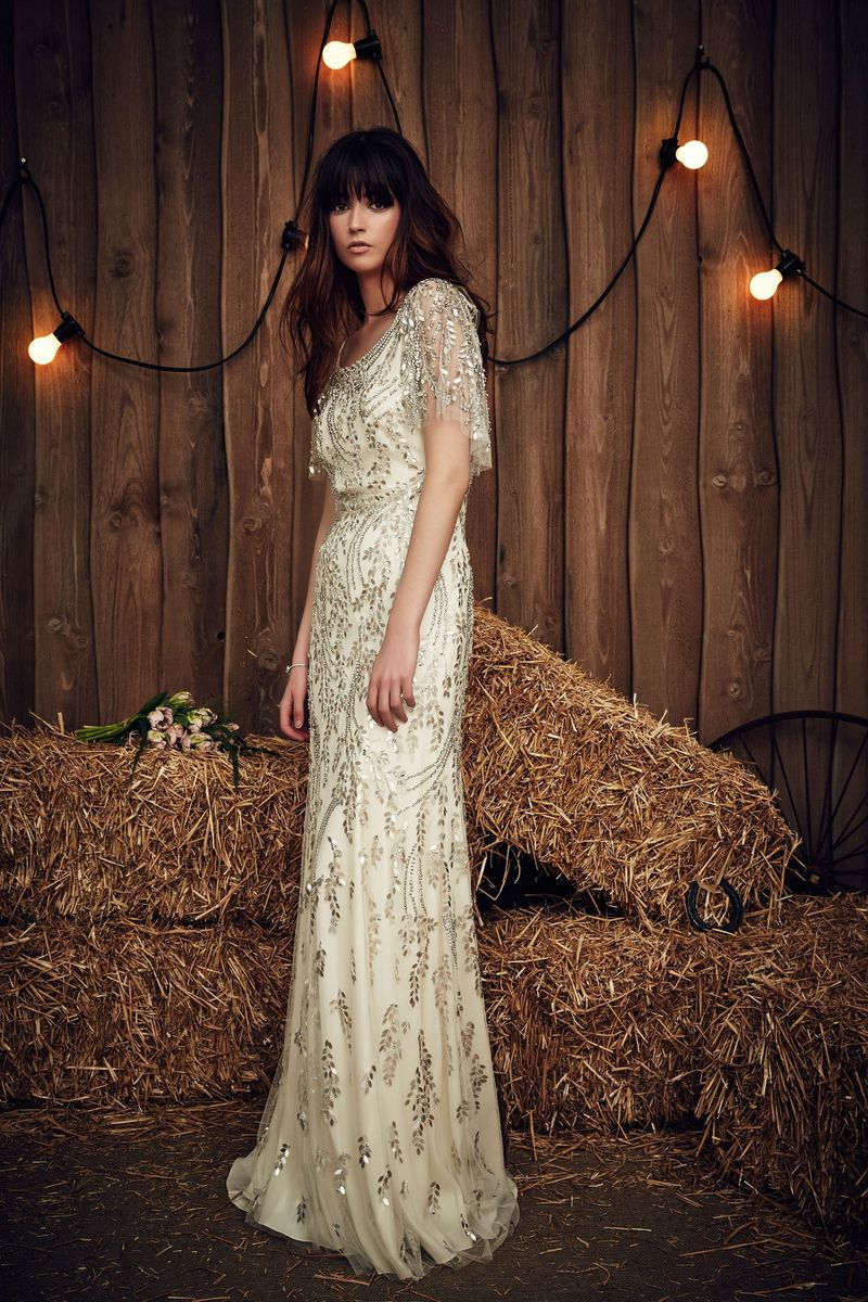 Where to buy a modest wedding dress racked a bride wearing a beaded wedding gown in a barn junglespirit Images