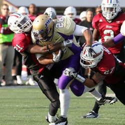 """In this photo taken Nov. 19, 2011, Massachusetts's Kirk Helms (21) and Darren Thellen (27) bring down James Madison's Jordan Anderson(28) during the first half of an NCAA football game on the UMass campus in Amherst, Mass.  Five programs """""""" Georgia State, Texas-San Antonio, South Alabama, Massachusetts and Texas State """""""" are at various stages in the two-year transition process to the top-tier Football Bowl Subdivision this season."""