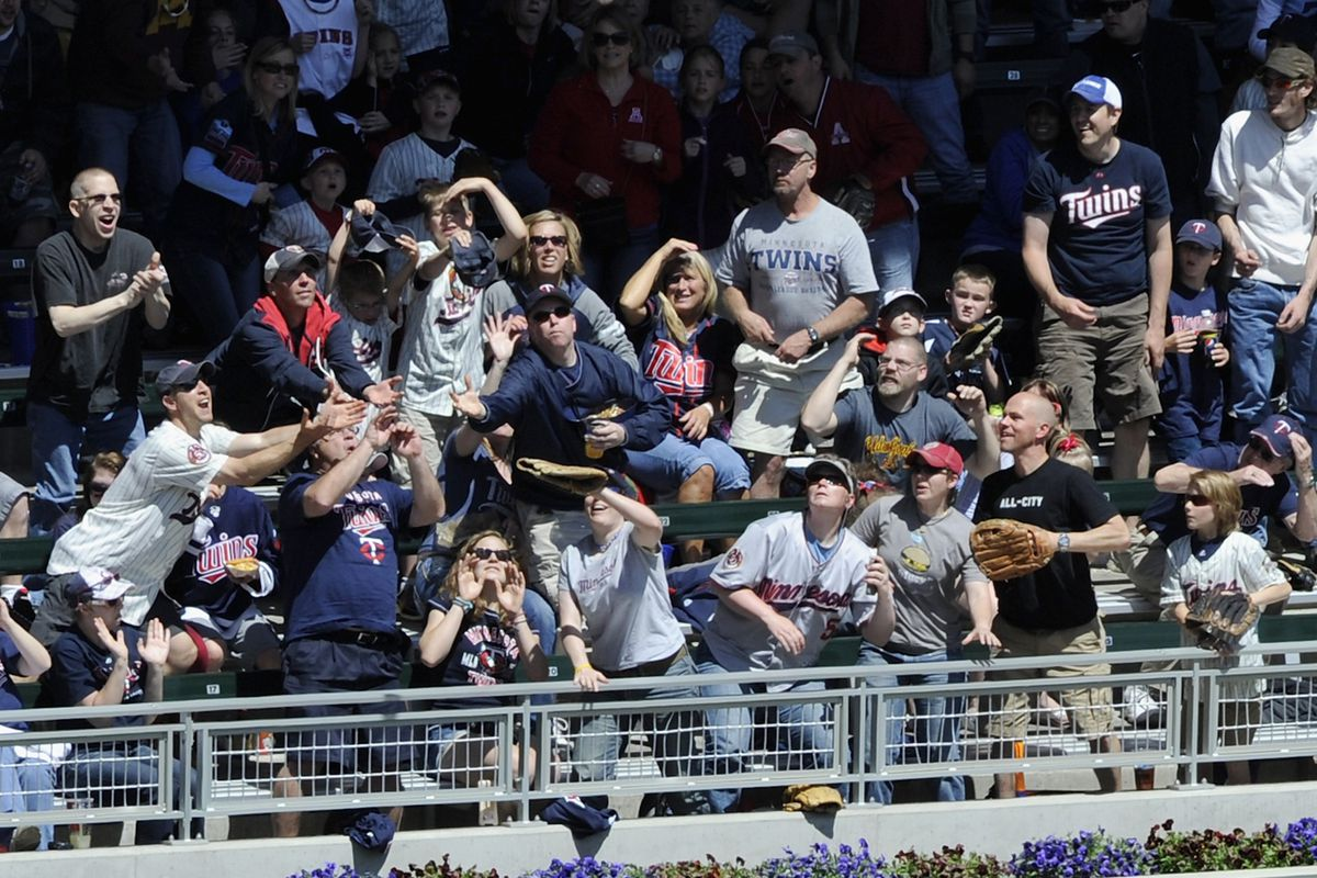 Just the best fans in baseball, trying to catch a home run.