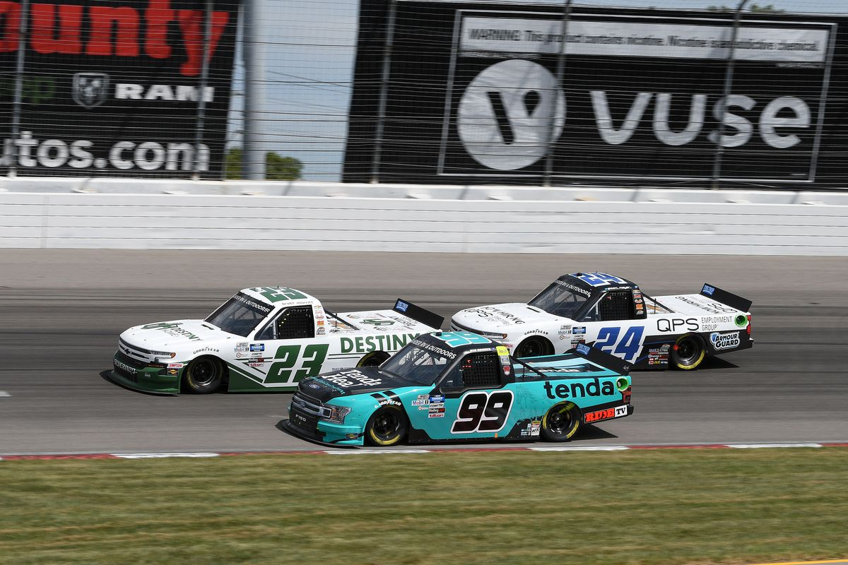 Brett Moffitt (23) GMS Racing Chevrolet Silverado, Ben Rhodes (99) ThorSport Racing Ford F-150, and Sam Mayer (24) GMS Racing Chevrolet Silverado race through turn three during the NASCAR Gander RV & Outdoors Truck Series iHeart 200 on August 30, 2020, at World Wide Technology Raceway at Gateway in Madison, Illinois.