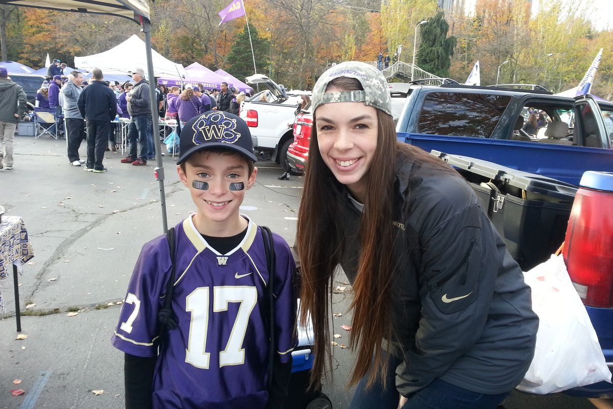 Krista Vansant and a young Husky fan at a tailgate
