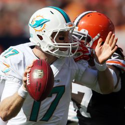 Sep 8, 2013; Cleveland, OH, USA; Miami Dolphins quarterback Ryan Tannehill (17) avoids Cleveland Browns linebacker Jabaal Sheard (97) during the third quarter at FirstEnergy Field. The Dolphins won 23-10.