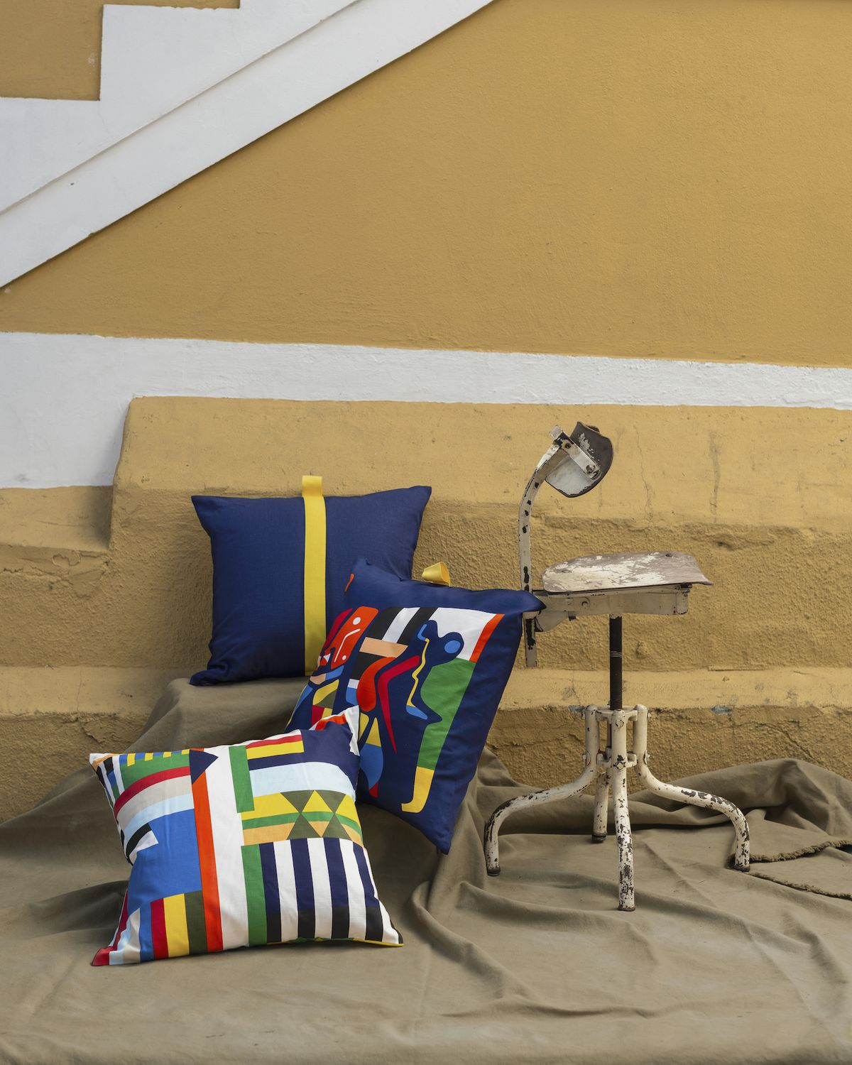 Colorful pillows leaning against wall