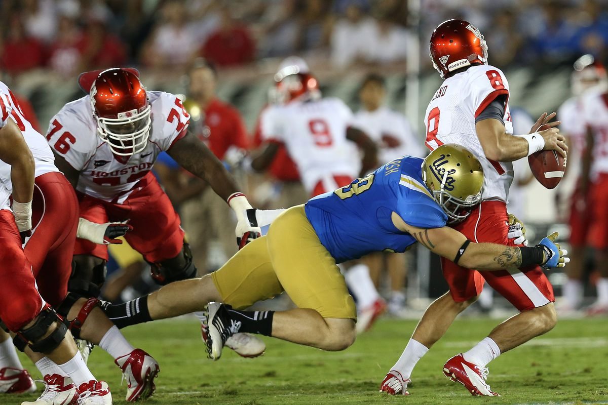 PASADENA, CA - SEPTEMBER 15: Defensive Cassius Marsh #99 of the UCLA Bruins sacks quarterback David Piland #8 of the Houston Cougars at the Rose Bowl on September 15, 2012 in Pasadena, California.  (Photo by Stephen Dunn/Getty Images)