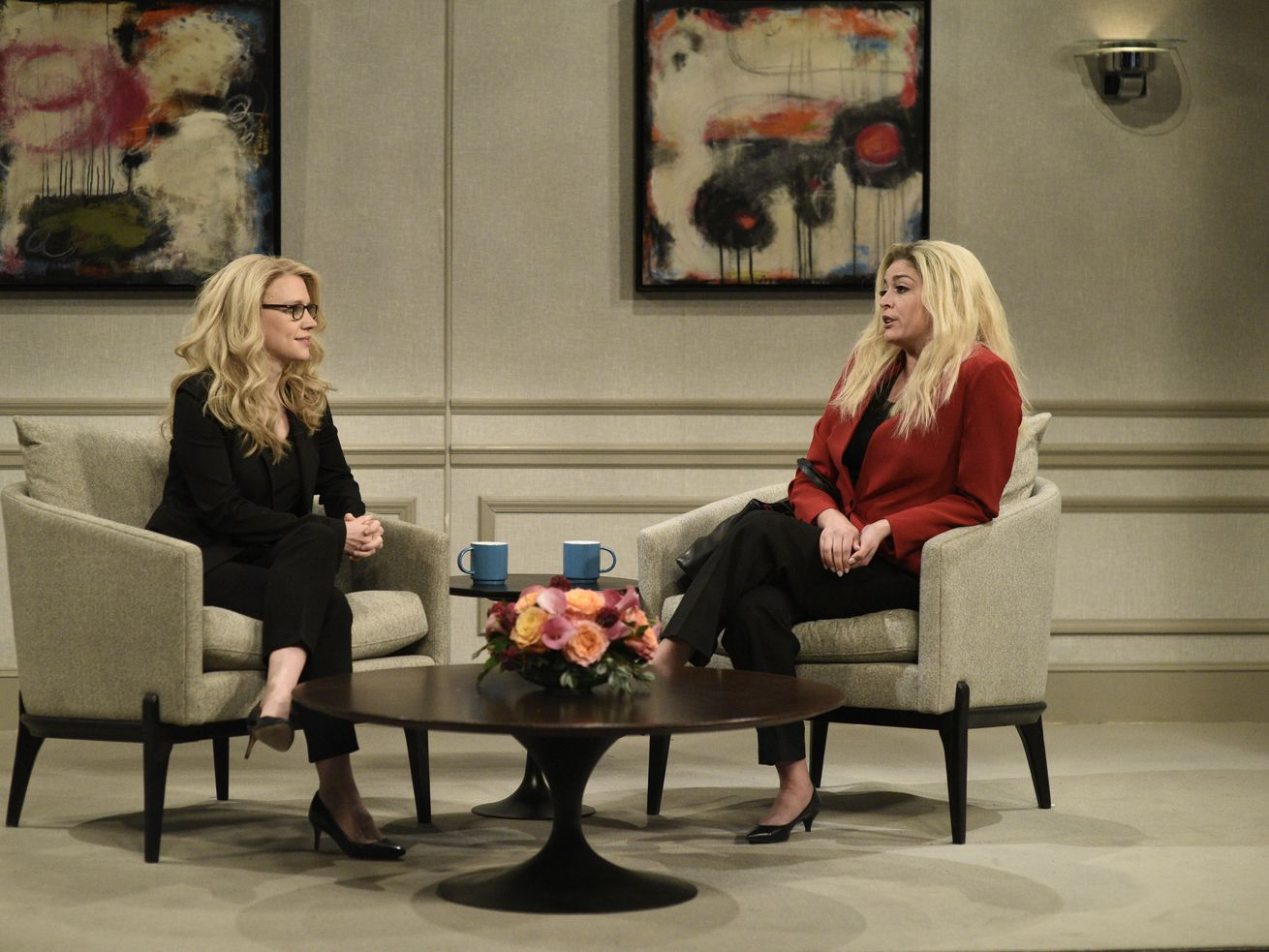 Cecily Strong, playing US Rep. Marjorie Taylor Green, speaks to Kate McKinnon, playing herself, in Saturday Night Live's January 30 cold open.