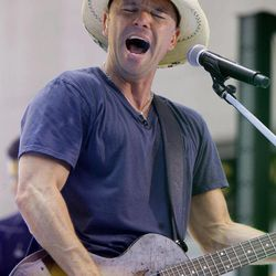 """FILE - In this June 17, 2011 file photo, singer Kenny Chesney performs on the NBC """"Today"""" television program in New York. Chesney is up for nine Academy of Country Music Awards on Sunday, April 1, 2012."""