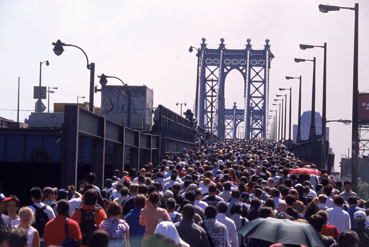 Crowds swarm over the Manhattan Bridge to leave Manhattan on the morning of the 9/11 attack.