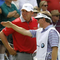 Bo Van Pelt, left, listens to caddie Mark Chaneyto on the 10th hole during the first round of the BMW Championship PGA golf tournament at Crooked Stick Golf Club in Carmel, Ind., Thursday, Sept. 6, 2012.