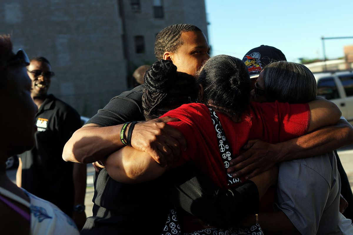 Mourners near a memorial where the police officers were shot and killed