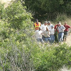 """Rescue workers bring out the last of four hikers who died in a cave on """"Y"""" mountain in Provo."""