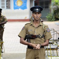 Sri Lankan police officers stand guard at a deserted polling station in Batticaloa, Sri Lanka, Saturday, Sept. 8, 2012 . Sri Lankans voted Saturday in a provincial assembly election seen as a test of whether ethnic minority Tamils still want self-rule or are satisfied with government-led economic development in a region devastated by a quarter-century civil war. As of noon, only small numbers of voters had turned out at polling booths in Batticaloa, one of three districts in Eastern Province.