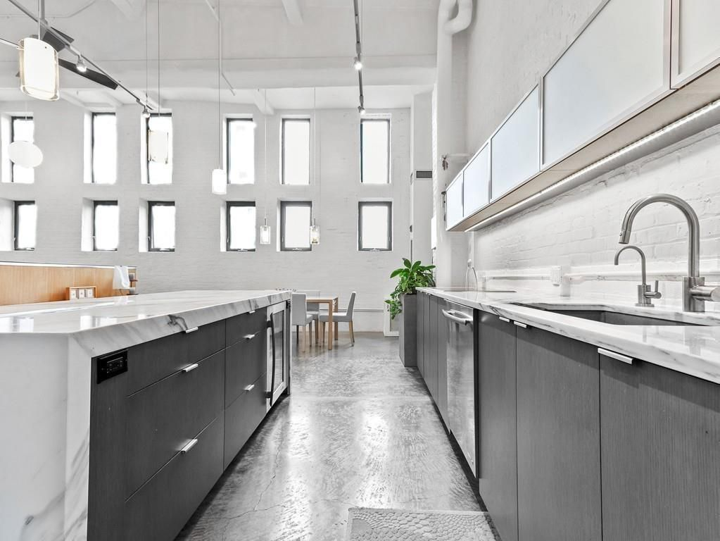 A long, open kitchen with counters on either side.