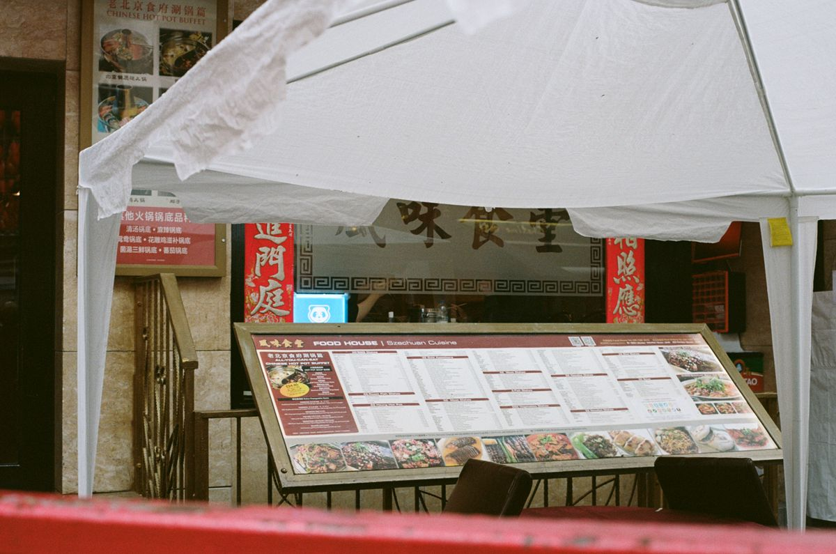 Outside Food House on Gerrard Street in London's Chinatown a gazebo offers shelter for those still wishing to dine outdoors