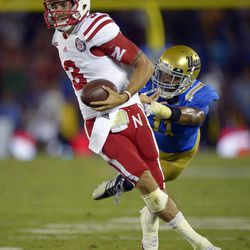 Nebraska quarterback Taylor Martinez, left, breaks a tackle by UCLA linebacker Anthony Barr as he runs the ball during the second half of their NCAA football game, Saturday, Sept. 8, 2012, in Pasadena, Calif. UCLA won 36-30.
