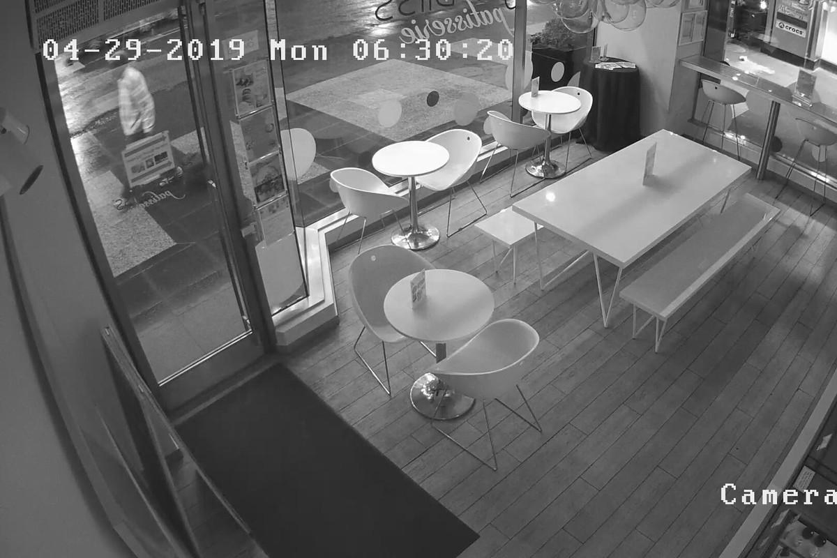 Surveillance video of man walking past store